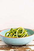 Courgettes noodles in a ceramic bowl