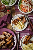 Pork ribs with chips and salad (seen from above)