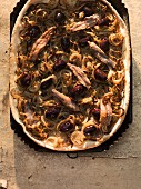 Oriental onion cake with anchovies and olives