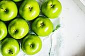 Green apples on a white napkin
