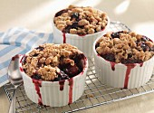 Three blueberry crumbles