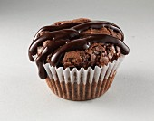 A chocolate muffin with chocolate glaze