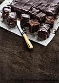 Brownies on kitchen paper with a knife