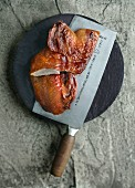 Roasted duck on a meat cleaver (China)