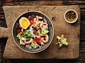 Thai salad with prawns, egg and broccoli