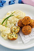 Fish balls with a mayonnaise and potato salad