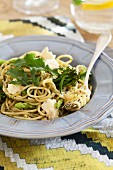 Spaghetti with herb pesto, broccoli, green asparagus, feta cheese and rocket
