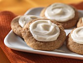 Pumpkin biscuits with white icing
