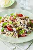 Wholemeal penne pasta with courgette, tomatoes and mushrooms