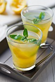 Ginger and mint tea with lemon zest
