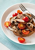 Sausages, mushrooms and cherry tomatoes on toast