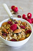Breakfast cereal with almonds and fresh raspberries