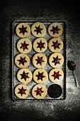 Christmas biscuits with jam stars and icing sugar