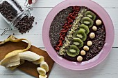 A smoothie bowl with acai berries and super foods (seen from above)