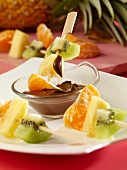 Fruit skewers with chocolate and peanut cream