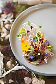 Langoustine and veal fillet tatar, caviar and flowers by Tohru Nakamura from Geisels Werneckhof in Munich