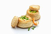 Vol-au-vents filled with salmon and prawns