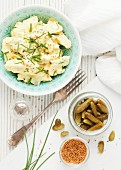 Potato salad with mustard seeds, chives and cornichons