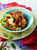 Kefta with a cucumber and pepper salad