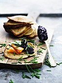 Blinis with smoked salmon, caviar and chives