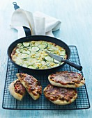 Courgette and sweetcorn omelette and mini pizzas with beef and peppers