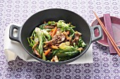 Stir-fried beef strips with bok choy and walnuts