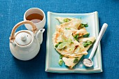 Pancakes with spring onions served with tea