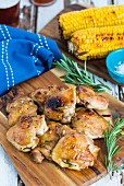 Grilled chicken legs and corn cobs with rosemary