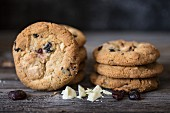 A stack of cookies with white chocolate and dried cranberries