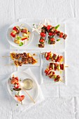 Various skewers on white plates for a Christmas party