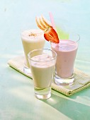 A soya grapefruit drink, a strawberry yoghurt frappe and an apple and vanilla milkshake