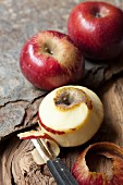 Red Renette apples, one peeled