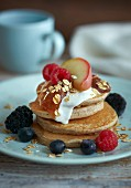 Pancakes with fresh fruit, jam and sour cream