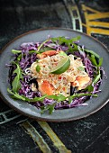 Crab salad with rice noodles on julienned red cabbage