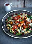Couscous salad with roast sweet potatoes and pomegranate seeds