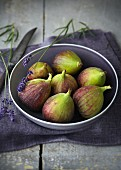 Fresh figs in a grey bowl