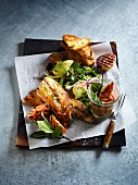 Cod with salad, grilled fruit, grilled bread and guava achaar