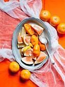 Pink grapefruit slices, lemons, juiced oranges and mandarins