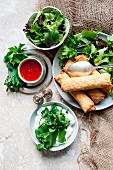 Spring rolls with lettuce leaves and a sweet chilli dip (Asia)