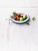 Tomato and mozzarella skewers with rosemary