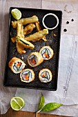 Fried tuna fish sushi rolls with marrow squash in tempura batter