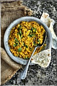 Yellow lentil with curry, garlic and coriander