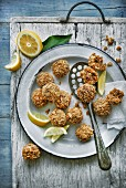 Fried lamb meatballs with lemons