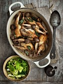 Braised quails with mushrooms served with a savoy cabbage medley