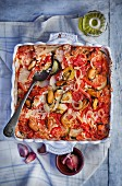 Vegetable bake with mussels, potatoes, tomatoes, onions, courgette and rice