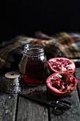 Pomegranate jelly and a halved pomegranate
