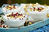 Yoghurt dessert with pistachios and dried rose petals