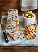 Pork knuckle terrine with gherkins and grilled bread
