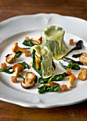 Spinach ravioli with quail and wild mushrooms