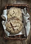 Two loaves of rye bread in a bread basket